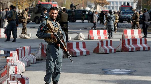 Afghan policemen at site of a previous blast in Kabul, November 12, 2018