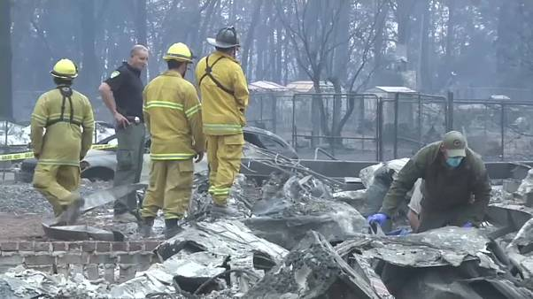 Firefighters work around the clock to dampen down Malibu fires