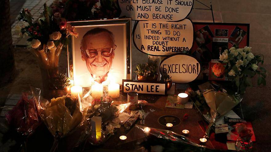 Flowers and mementos are pictured on the star of Stan Lee