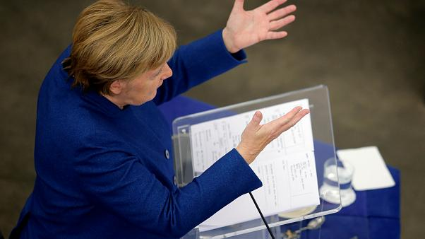 The Brief: Merkel's message, Brexit visas and cheese copyright