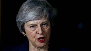 May survives first Brexit hurdle as Brussels publishes draft deal
