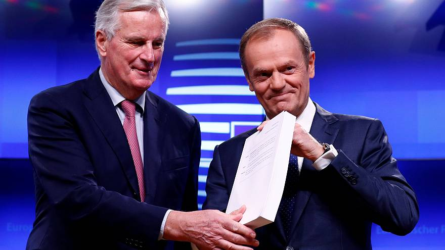 Michel Barnier hands the Brexit withdrawal agreement to Donald Tusk