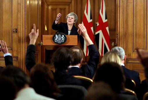 Theresa May takes questions during a news conference
