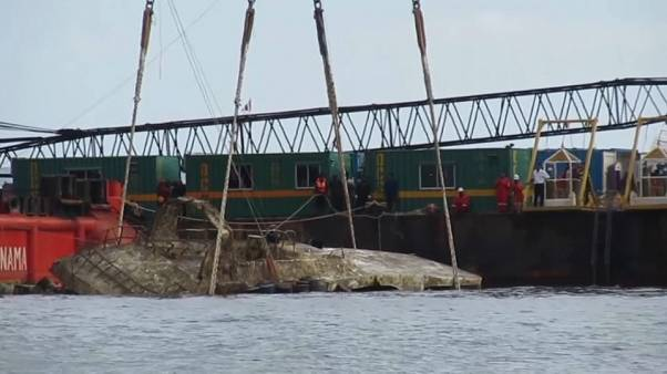 Tourist boat that sank in Thailand is raised to surface