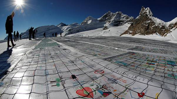 Climate change: giant postcard aims to highlight Europe's shrinking glaciers