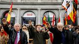 Supporters of Spain's late dictator Francisco Franco give fascist salutes