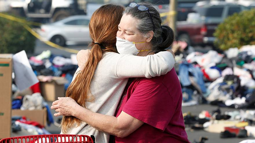 Evacuees from the Camp fire embrace at a makeshift camp in California