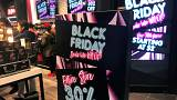 A Black Friday sale sign is displayed outside a makeup store