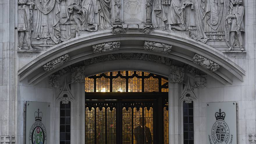 A member of security stands guard inside the Supreme Court in London