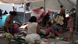 Migrants camped out in Mexico attend job fair