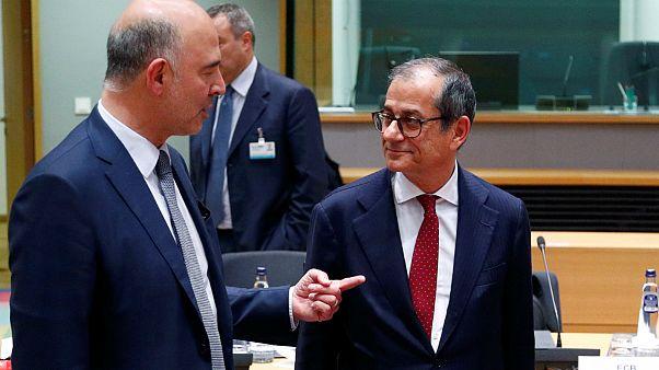 O comissário europeu Pierre Moscovici com o ministro Giovanni Tria