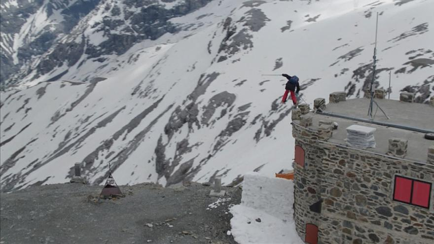 Watch: Freestyle skiers jump roads on Italy's highest mountain pass