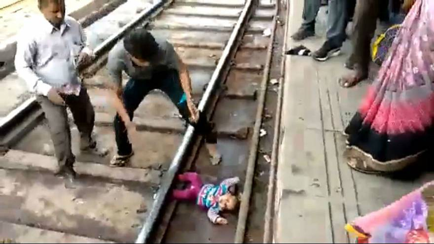 Watch: Baby in India survives after being 'run over' by train