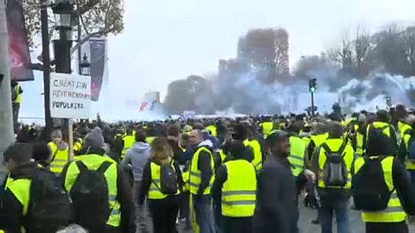 Police fire tear gas at yellow vest protesters in Paris