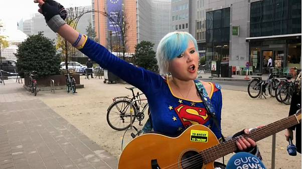 EU Supergirl sings 'anti-Brexit' song outside Brussels summit