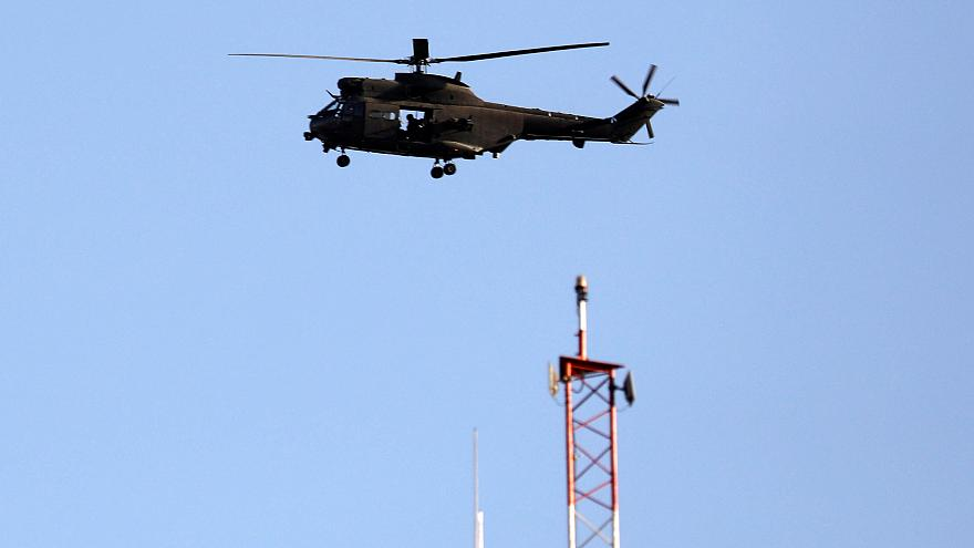 File: NATO helicopter flies over Resolute Support headquarters in Kabul.