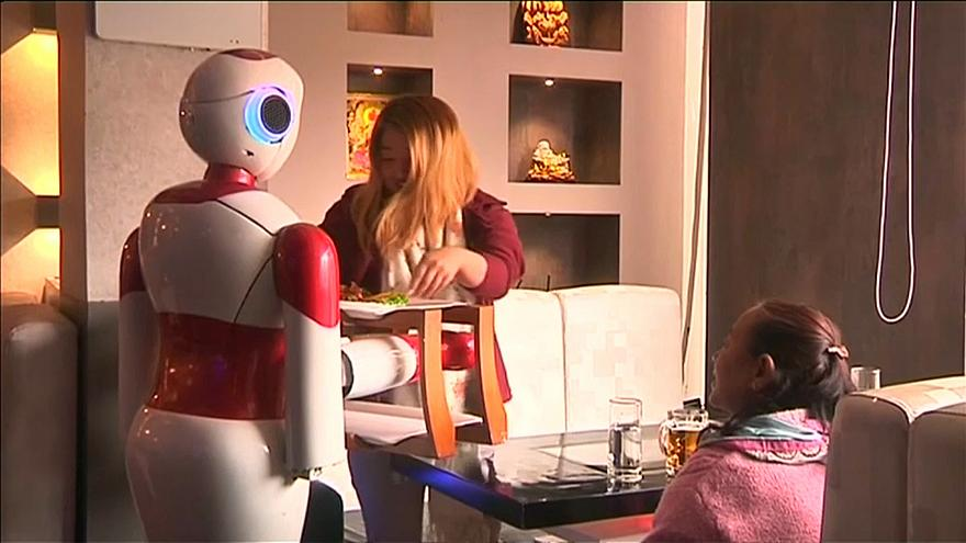 Locally made robots wait tables at Kathmandu restaurant