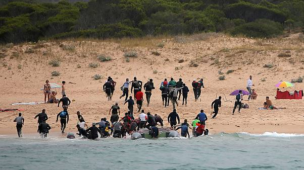 Migrants on Del Canuelo beach, after they crossed the Strait of Gibraltar