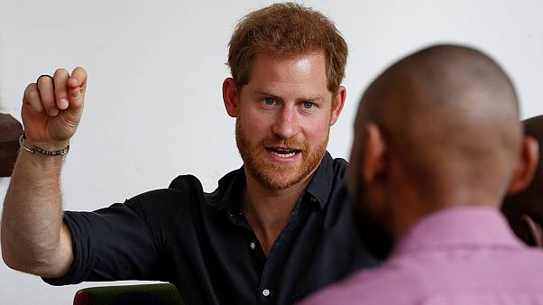 Prince Harry speaks to youths during a visit to BongoHive in Lusaka