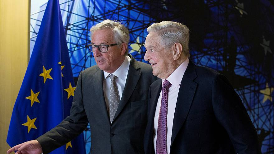 File photo of George Soros and Jean-Claude Juncker