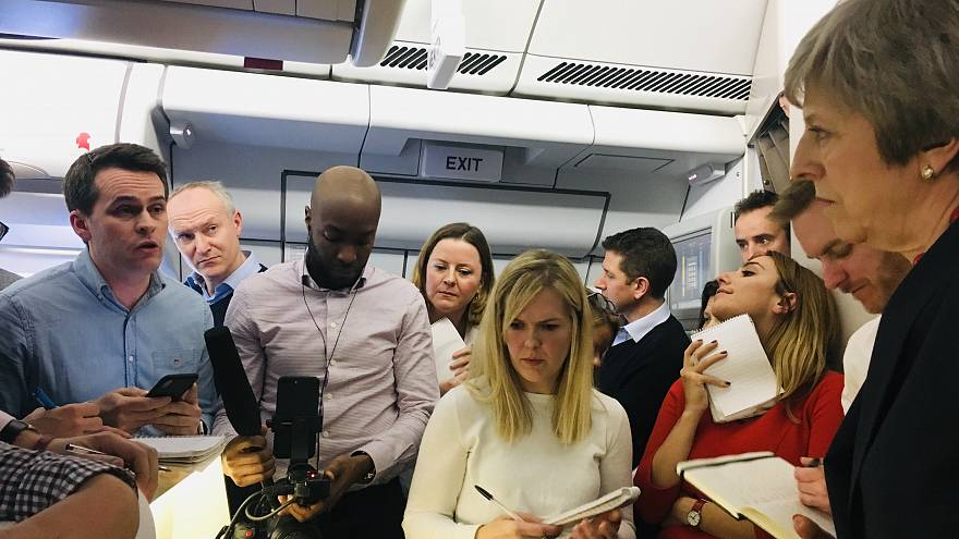 Theresa May speaks to journalists on her plane