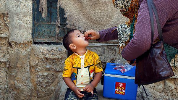 Boy receives polio vaccine drops, Karachi, Pakistan April 9, 2018.