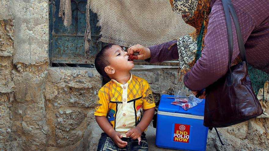 Boy receives polio vaccine drops, Karachi, Pakistan April 9, 2018.