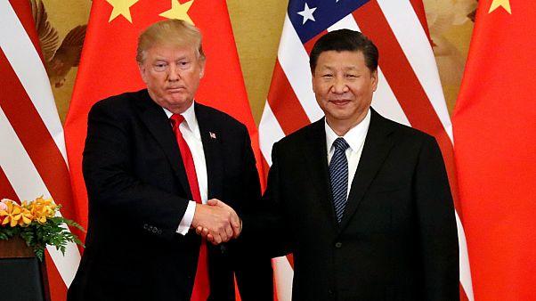 أمريكا والصين تعلنان وقف فرض تعريفات تجارية جديدة
