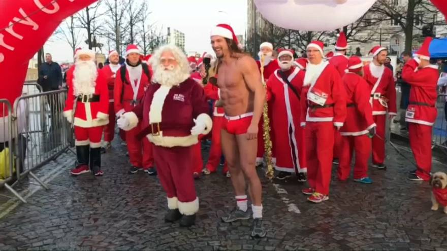 Hundreds of Santas dash around the English city of Liverpool