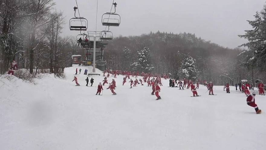 Hundreds of Santas hit the ski slopes for charity