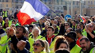 People wearing yellow vests, a symbol of a French drivers' protest against
