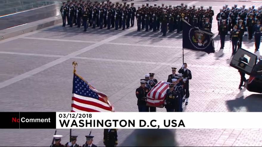 Emotional George W. Bush watches his father's casket arrive at US Capitol