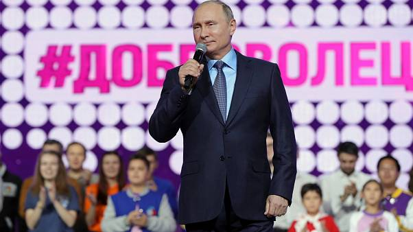 Putin delivers a speech at the International Volunteer Forum in Moscow