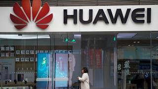 Stocks slide as Huawei arrest risks new strains in U.S.-China ties