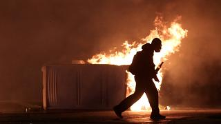 Clashes in Athens as protesters mark anniversary of teen shooting