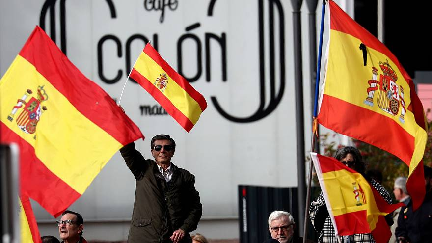 People gather at a rally calling for Spanish national unity in Madrid.