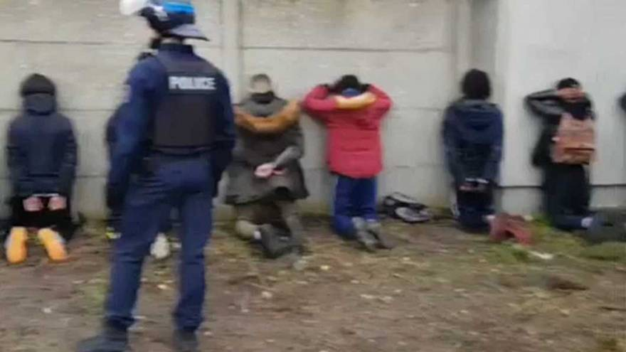 Anger over video of French police surrounding kneeling teenage protesters