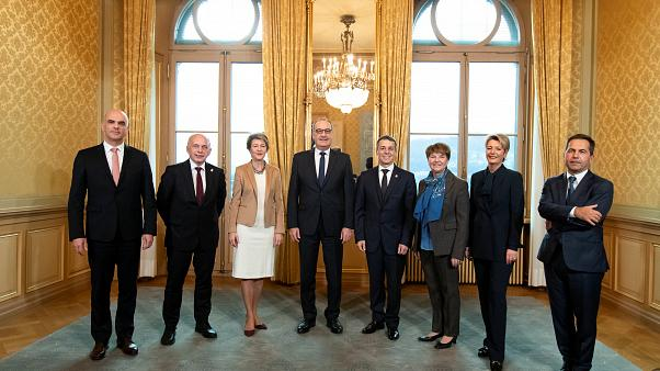Swiss Federal Chancellor Walter Thurnherr (R) and the Federal Council.