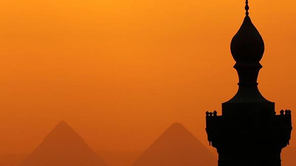 Sun sets over Great Pyramids of Giza where the couple alledgeldy posed nude
