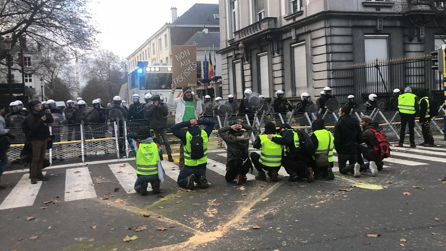 Protestors clash with police in Brussels