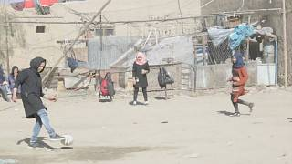 Women play footbal in the streets of Kabul