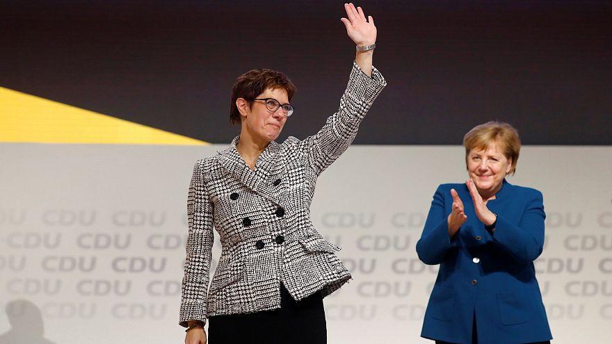 Annegret Kramp-Karrenbauer waves to CDU delegates after her election.