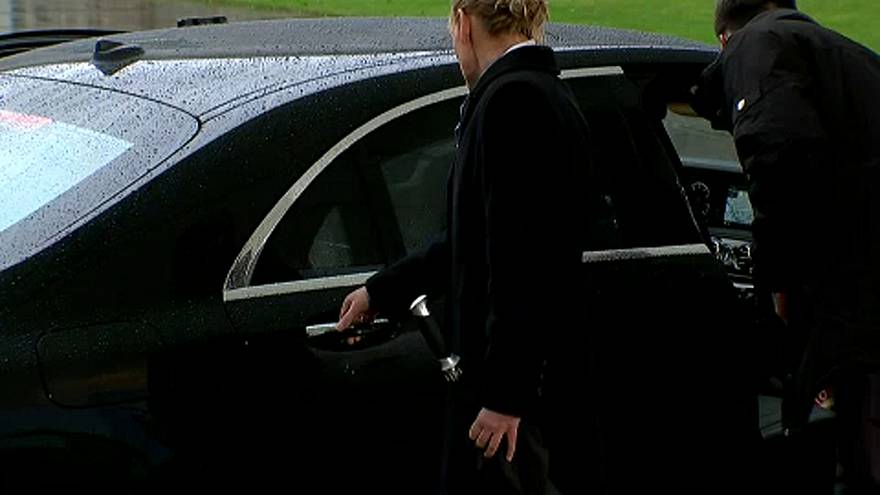 Theresa May prepares to leave her car