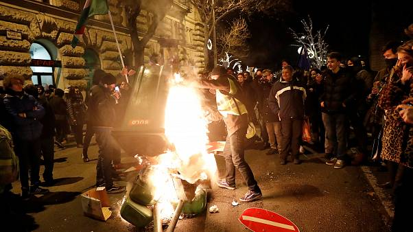 """Prostesters against the new """"slave law"""" burn bins in front of parliament"""
