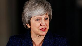 Theresa May heads to Brussels after winning vote of no confidence