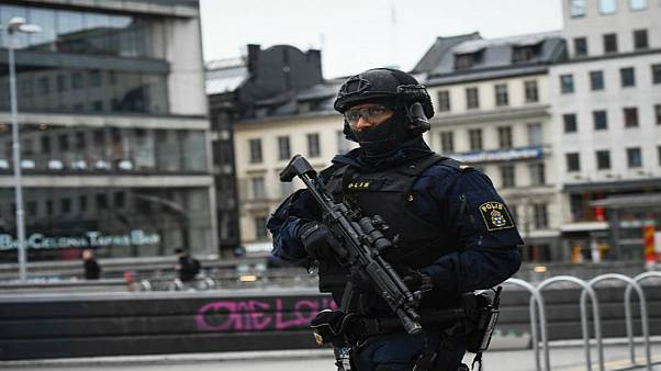 An armed police officer patrols in Stockholm following 2017's attack