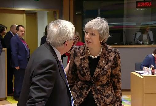 Theresa May and Jean-Claude Juncker caught on camera in tense exchange