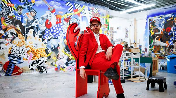Fashion designer and artist Philip Colbert sits at his studio in Shoreditch