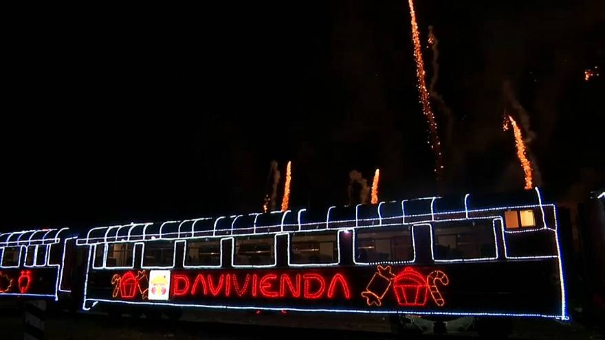 Illuminated train chugs through Bogota bringing Christmas cheer