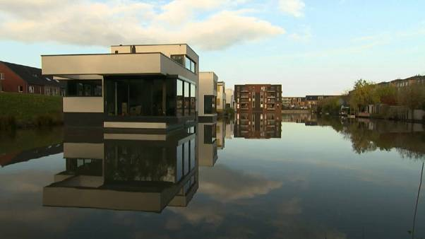 Dutch turn to floating homes to confront rising sea levels